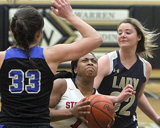 William D. Lewis The vindicator  Lakeview's Annie Pavlansky(33)  and Brookfield's Tori Sheehan (32) defend against Struthers Khaylah Brown(1) during Bubba action at Warren Harding.