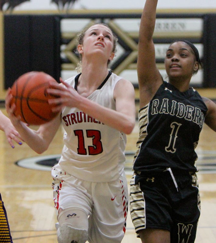 William D. Lewis The vindicator  Struthers Alexis Bury(13) shoots past HArding's Brayleonna Wood(1) during Bubba action at Warren Harding.