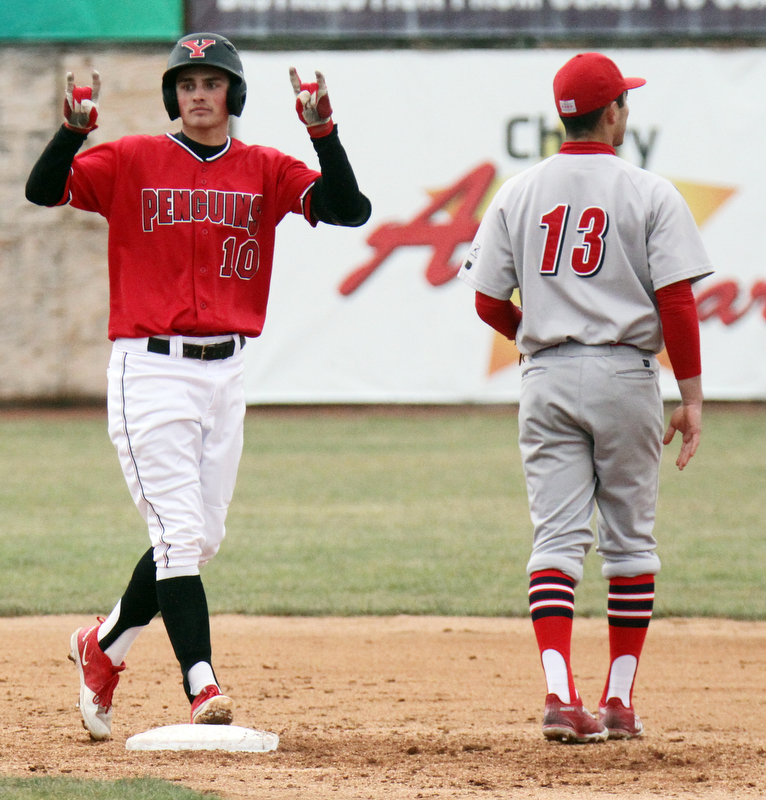 William D. Lewis The Vindicator YSU's Cody Dennis (10) reacts after hitting a double during 3-30-18 game at Eastwood. At right is UIC's Ryan Lin-Peistrup.