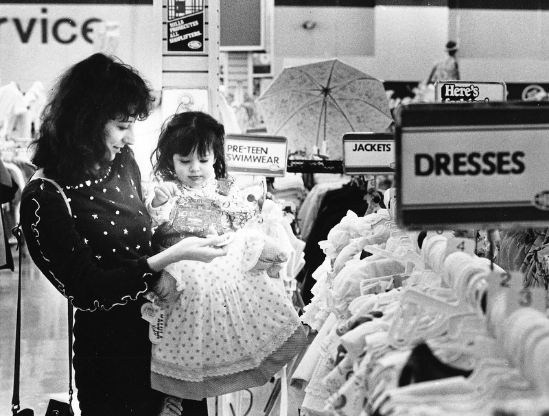 EASTER FASHIONS: New spring bonnets and dresses are always a part of Easter Sunday.  Lorilee Amedia of Youngstown prepared her 11Ú2-year-old daughter, Michal, for her second Easter celebration Saturday by shopping at the Hills Department Store in the Liberty Plaza...Photo by William D. Lewis Ð The Vindicator