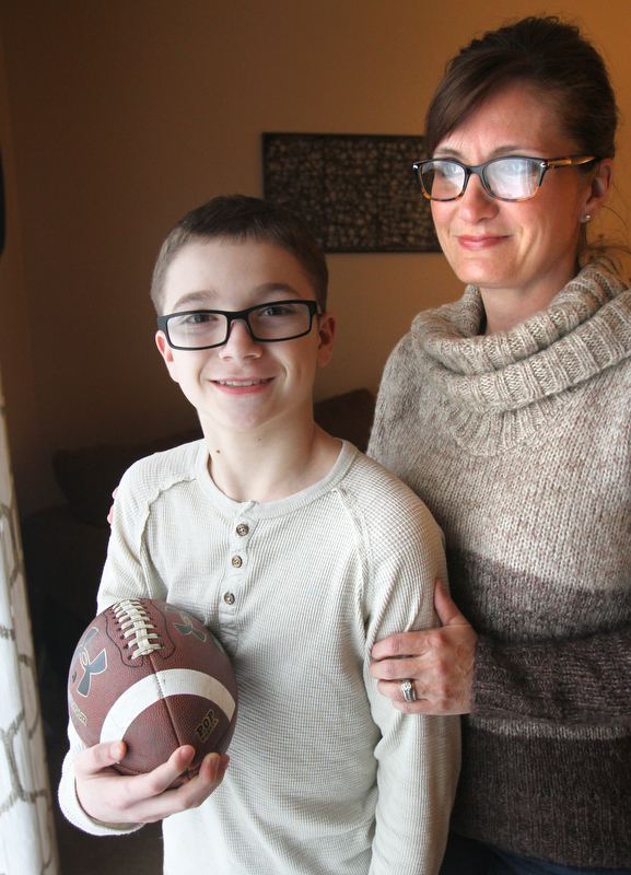 William D. Lewis The vindicator Peyton Switka who has cystic fibroisis and plays a number of sports, and his mother Shannon Switka in their Boardman home 3-27-18.