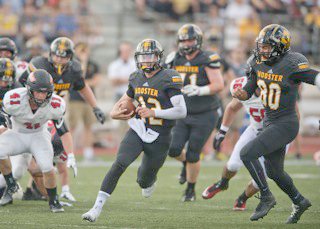 Struthers graduate Gary Muntean (12) is Wooster's all-time leading passer. He now hopes to continue to play football at the professional level.