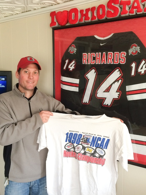 Chris Richards of Austintown holds his 1998 Frozen Four souvenir t-shirt in front of his framed Ohio State hockey jersey. Twenty years ago, Richards was the second-leading scorer on the Buckeyes' last Frozen Four team.