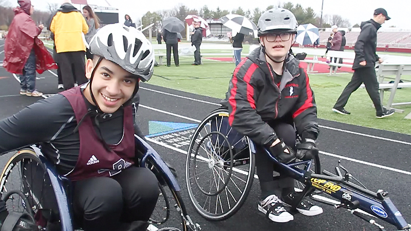 Micah Beckwith of Boardman, left, defeated Jake Hostetter of Canfield, in the first seated-athlete track and field race Tuesday at Boardman.
