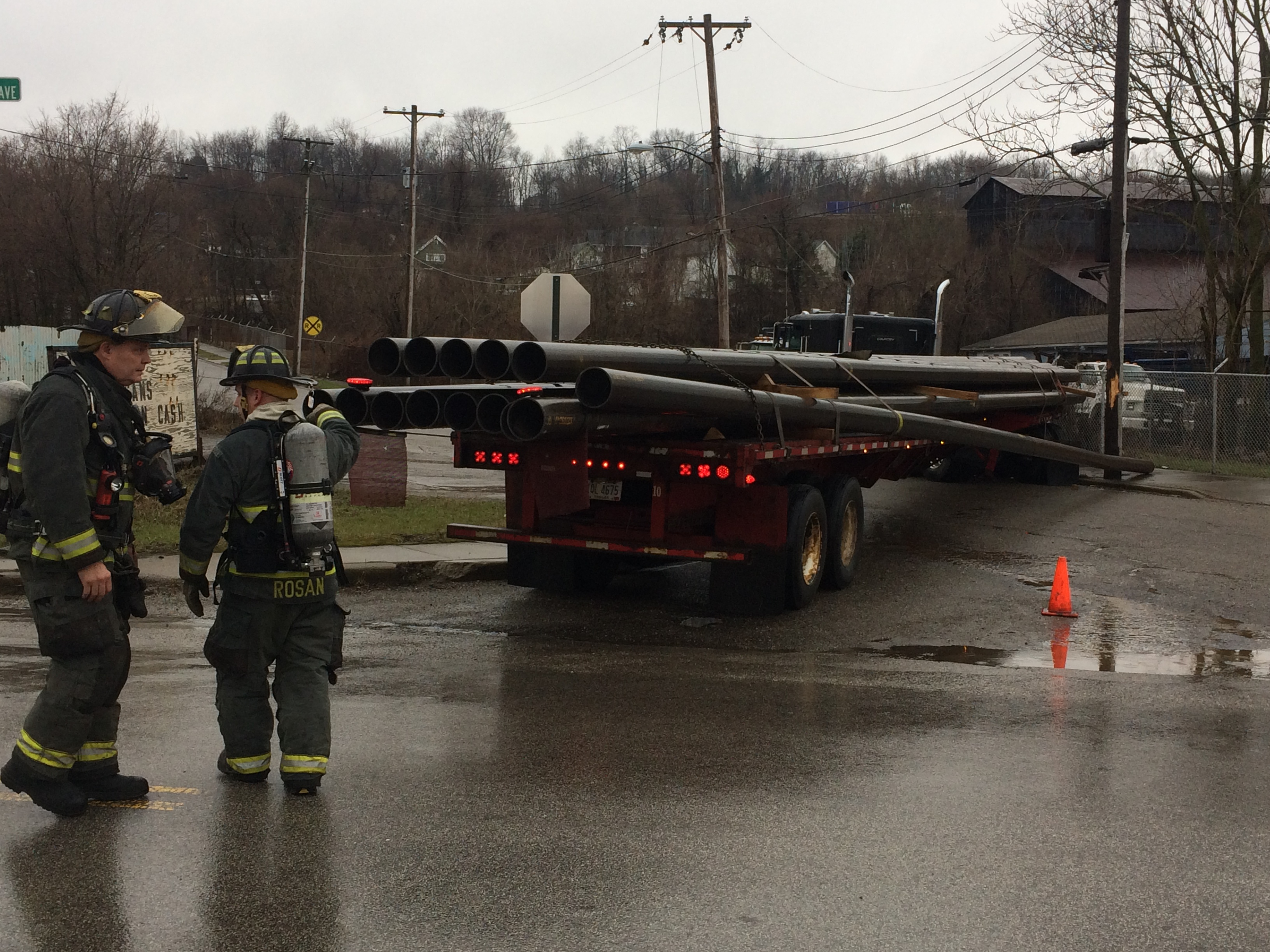 Poland Avenue is closed at Powersdale Avenue after this truck carrying steel pipes struck a pole.