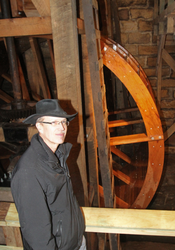 William D. Lewis the Vindicator   Steve Avery Mill Creek Park Planning and Operations Director stands near the newly restored waterwheel at Lantermans Mill.  ribbon cutting ceremony was held 4-6-18.
