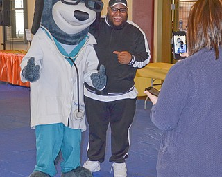 "Kaylee Kapalko, Canfield, from United Health Care, takes a photo of Charles ""DJ Chip Banks"" Colvin, who was providing music, and ""Dr. Health E. Hound"" at the ""Citywide Baby Shower"" at the Eugenia Atkinson Recreational Center Saturday, April 7, 2018.