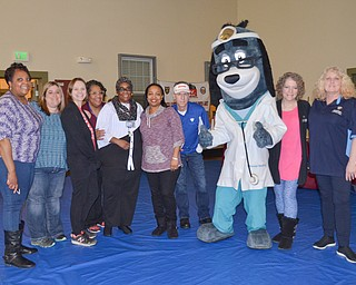 "Members from the Youngstown City Health District who volunteered at the ""Citywide Baby Shower"" at the Eugenia Atkinson Recreational Center Saturday, April 7, 2018, pose with ""Dr. Health E. Hound"" at the event's close.  From left to right, they are: Andrea Bivens-Flakes, Erin Bishop, Faith Terreri, Leigh Green, Golie Stennis, Michelle Thomas, Richard Dezsi, ""Dr. Health E. Hound,"" Paula Lewis, and Sandra Pazanavich.