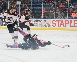 Youngstown Phantom #17, Joey Abate, goes for a ride on the ice after being tripped by Chicago Steel #26, Aaro Vidgren, at the Youngstown Phantoms vs. Chicago Steel hockey game at Covelli Centre on Saturday April 7, 2018.