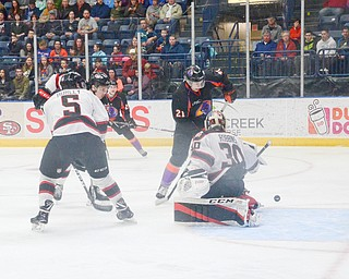 Chicago Steel #30, Justin Robbins, narrowly stops Youngstown Phantom #21, Michael Regush, from putting the puck in the net at the Youngstown Phantoms vs. Chicago Steel hockey game at Covelli Centre on Saturday April 7, 2018.