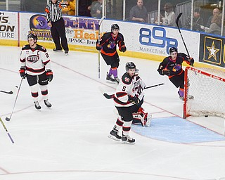 Youngstown Phantom #6, Max Ellis, puts one past Chicago Steel #30, Justin Robbins, to put the Phantoms on the board at the Youngstown Phantoms vs. Chicago Steel hockey game at Covelli Centre on Saturday April 7, 2018.