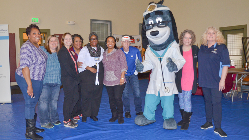 Mascot Dr. Health E. Hound poses with members of the Youngstown City Health District who volunteered at the Citywide Baby Shower at the Eugenia C. Atkinson Recreational Center. Saturday's event focused on letting young mothers, and those expecting, learn about the community resources available to help them care for their babies. The shower also included a health fair.