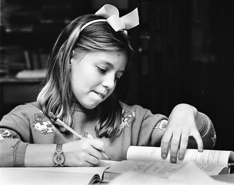 TOUGH SUBJECT: Heidi Duff, a middle school student at The Kennedy School for the Gifted on Broadway Avenue in Youngstown, ponders math problems.  Photo taken April 8, 1987.  Photo by Robert DeMay - The Vindicator