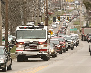 ROBERT K.YOSAY  | THE VINDICATOR.. over 150 cars were in the procession which the firetruck carried the body of chief randall pugh - the procession went south on 46 from mineral ridge to Greenhaven funeral home in canfield.funeral of Weathersfield Township Fire Chief Randall Pugh, who died April 2..-30-
