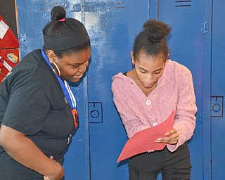 Brianna James, 11th grade, (left) and Talasia Vazquez, 9th grade, review lines of the Destination Imagination skit at East East School on Monday, April 9, 2018.