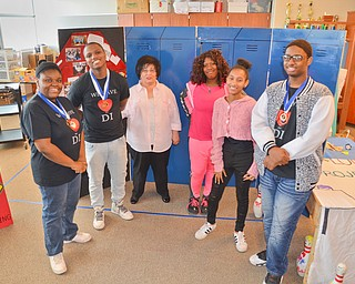 The Destination Imagination group with their props at East East School on Monday, April 9, 2018.  From left to right, Brianna James, 11th grade, Kaysonn Madison, 10th grade, advisor Ms. Jeanne Constantino, Santajah Douglass, 10th grade, Talasia Vazquez, 9th grade, and Marquan Stevenson, 11th grade.