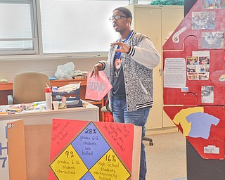Marquan Stevenson, 11th grade, a member of the Destination Imagination group at East East School, talks about some of the bullying statistics that the group discovered on Monday, April 9, 2018.