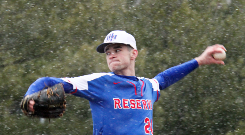 William D. Lewis The Vindicator Western Reserve pitcher Dom Velasquez(24)during snowy 4-9-18 game at Cene with Lowellville.