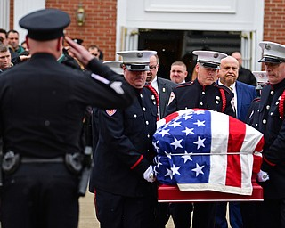 WEATHERSFIELD, OHIO - APRIL 9, 2018: Weathersfield Township Fire Chief Randall Pugh's casket is walked outside of the First Presbyterian Church of Mineral Ridge after the conclusion of his funeral, Monday morning. DAVID DERMER | THE VINDICATOR