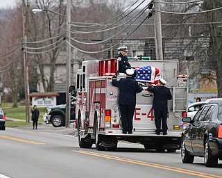 WEATHERSFIELD, OHIO - APRIL 9, 2018: A Weathersfield fire truck transporting Weathersfield Township Fire Chief Randall Pugh's casket drives on Route 46, after the conclusion of his funeral, Monday morning. DAVID DERMER | THE VINDICATOR