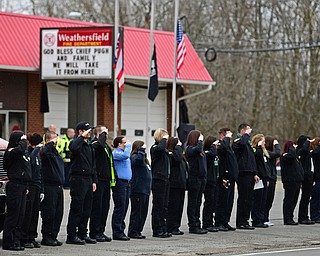 WEATHERSFIELD, OHIO - APRIL 9, 2018:Firemen and women stand and salute as the funeral procession for Weathersfield fire truck transporting Weathersfield Township Fire Chief Randall Pugh passes in front of the Weathersfield Township fire station, Monday morning. DAVID DERMER | THE VINDICATOR