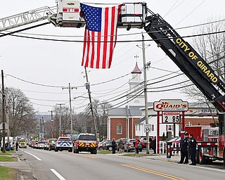 WEATHERSFIELD, OHIO - APRIL 9, 2018: The funeral procession for Weathersfield Township Fire Chief Randall Pugh drives on Route 46, Monday morning. DAVID DERMER | THE VINDICATOR