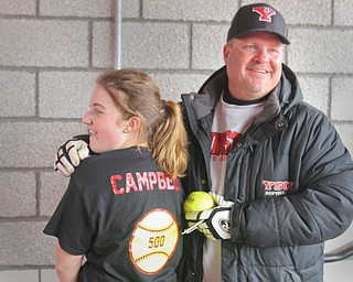 William D. Lewis The Vindicator  YSU softball coach Brian Campbell celebrates his 500th career win with his daughter Courtney, 14, after a win over NKU 4-10-18