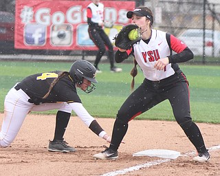 William D. Lewis The Vindicator  YSU Kelly Thompson Cappadocio (7) and KNU's Ava Lawson during 2nd game with NKU 4-10-18.