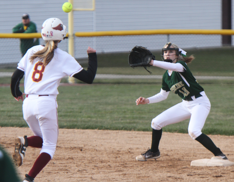 William D. Lewis The Vindicator Mooney's Lauren Frommelt(8) is out at 2nd. Making catch for ursuline is Maris Barbato during 4-11-18 game at Fields of Dreams.