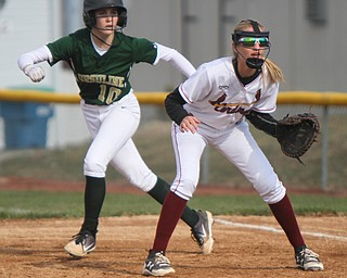 William D. Lewis The Vindicator  Ursuline's Maris Barbato(10) leads off first as Mooney 1rst baseman Lauren Frommelt(8)  waits for the throw during 4-11-18 game.