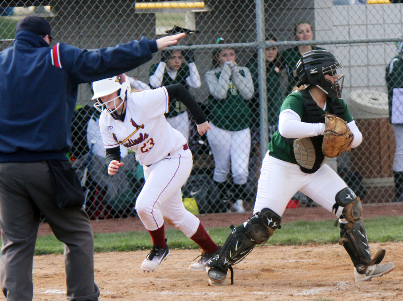 William D. Lewis The Vindicator  Mooney's Samantha Holden (23) is safe at home as Ursuline catcher Julia Nutter(17) looks to make a throw during 4-11-18 game at Fields of Dreams.