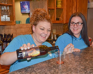 """Sisters Danielle Bodnar, left, and Gina Ginnetti happily pour drinks at the bar at the annual """"Taste of Struthers"""" event held at St. Nicholas in Struthers on Thursday April 12, 2018.  Photo by Scott Williams - The Vindicator"""