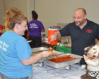 """Frank Lellio, right, serves up some of Belleria's finest to Danielle Bodnar at the annual """"Taste of Struthers"""" event held at St. Nicholas in Struthers on Thursday April 12, 2018.  Photo by Scott Williams - The Vindicator"""
