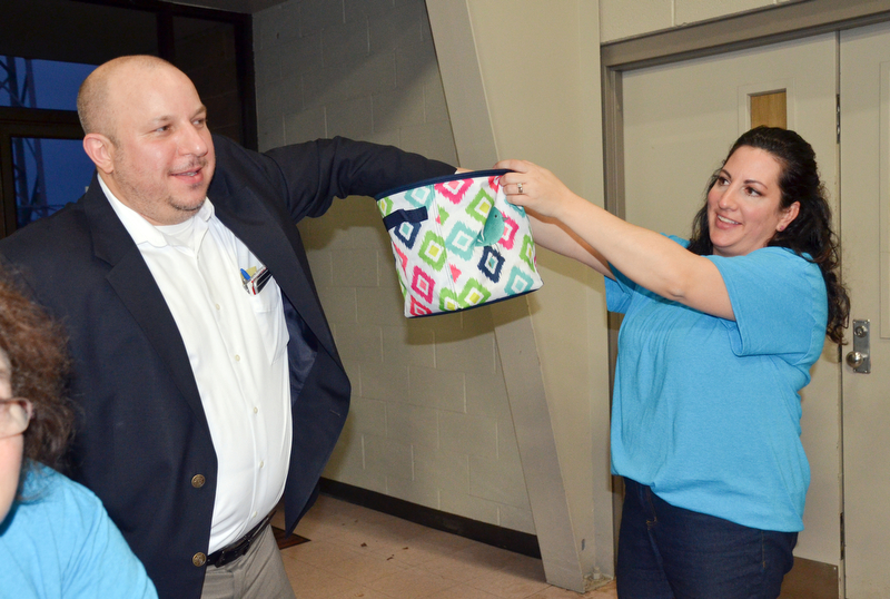 "Struthers Municipal Court Judge Dominic Leone, left, pulls a winning 50/50 ticket from Catherine Cercone Miller's basket at the annual ""Taste of Struthers"" event held at St. Nicholas in Struthers on Thursday April 12, 2018.