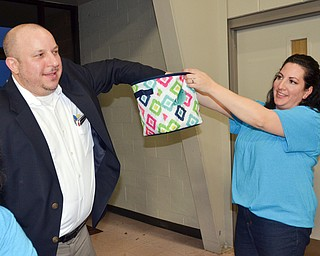"""Struthers Municipal Court Judge Dominic Leone, left, pulls a winning 50/50 ticket from Catherine Cercone Miller's basket at the annual """"Taste of Struthers"""" event held at St. Nicholas in Struthers on Thursday April 12, 2018.  Photo by Scott Williams - The Vindicator"""