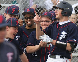 Fitch's Nick Belcik (14), right, gets congrats after hitting his first homer during 4-12-18 game with Columbiana.