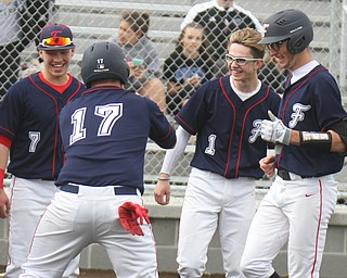Austintown Fitch's Nick Belcik (14), right, gets congrats from NKole Klacic (7) Nick Bianco (17) and Vinny Direnzo (1) after hitting a grand slam during 4-12-18 game with Columbiana.