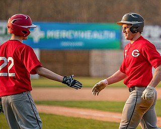 Girard's Braydon Freeland congratulates teammate Nick Malito after he hit an inside-the-park-homerun during their 10-1 win against Liberty at Eastwood Field Friday night.