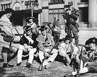 RECRUITS NEEDED - Joseph Alessi (standing left), commander of the Mahoning Valley Colonial Brigade, is seeking recruits for the group and asks interested persons to attend a meeting at 2:30 p.m. Today in the Bicentennial offices, 7 Federal Plaza West.  Parading Saturday in the plaza in observance of Washington's Birthday were (seated, from left) Terry Noble, Bill Jones, Roy Moore, and Arnold Ylonen and (standing from left) Alessi, Harry Noble, Jim Mann, and George Wedlin.  Photo published February 23, 1975.