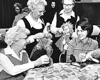 HOMESPUN HAPPENING - Bicentennial crafts, like these being worked by Mrs. Eloise Rupert and Mrs. Daniel Altsman (seated, left to right) and Elanor Davis and Marion Maiden (left to right, standing) will be available at First Presbyterian Church's bazaar and luncheon at the church from 10 a.m. to 4 p.m. Thursday.  Photo by Paul R. Schell.