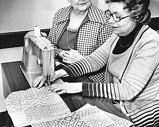 STITCH IN TIME - Mrs. Edward Reese (left) and Marietta Bagnall are working on patchwork napkins for the bazaar.  Reservations are needed for the luncheon from 11 a.m. to 2 p.m.  A sandwich bar will be available for those who do not want a full course meal.  Photo by Paul R. Schell.