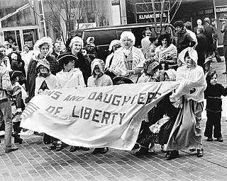 """RE-ENACT START OF AMERICAN REVOLUTION AT FEDERAL PLAZA - Buffeted by chilly spring winds, costumed members of """"The Sons and Daughters of Liberty"""" helped recreate a colonial atmosphere for the ceremony.  The group is a branch of the Mahoning Valley Colonial Brigade, led by Co. Joseph Alessi."""