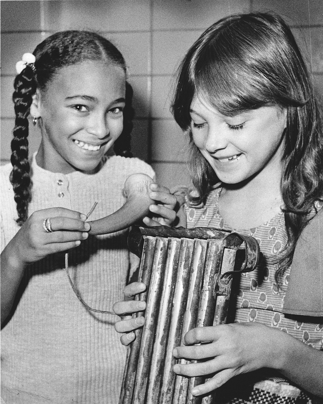Inspecting a powder horn and candle molds from a past era are Pamela Jackson (left) and Tina Lilley.