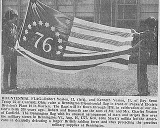 BICENTENNIAL FLAG - Robert Yeaton, 13, (left), and Kenneth Yeaton, 11, of Boy Scout Troop 25 of Canfield, Ohio, raise a Bennington Bicentennial flag in front of Packard Electric Division's Plant 10 in Warren.  The flags will be flown through 1976, in celebration of our nation's birth 200 years ago.  Robert and Kenneth are the sons of Mr. and Mrs. Charles Yeaton of Canfield.  The Bennington flag with its unusual arrangement of stars and stripes flew over the military stores in Bennington, Vt., Aug. 16, 1777.  Gen. John Stark's militia led the Americans in decidedly defeating a larger British raiding force and thus protecting the precious military supplies at Bennington.  Photo published June 20, 1975.