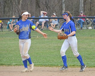 Poland Seminary's #12, Sarah Boccieri, (left) gives a high-five to #11, Laruen Sienkiewicz, (right) after ending the inning during their game against South Range in Poland on Saturday, April 14, 2018.