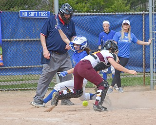 Safe by a mile - Poland Seminary's #1, Brooke Bobbey, is safe at home after South Range's #23, Jillian Strecansky, misses the throw home during their game in Poland on Saturday, April 14, 2018.