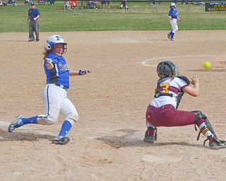 Poland Seminary's #7, Payton Slaina, is safe at home, but just barely, after beating the tag by South Range's catcher #23, Jillian Strecansky, during their game in Poland on Saturday, April 14, 2018.