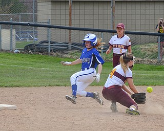 Poland Seminary's #9, Ashley Wire, has successfully stolen second base before South Range's #4, Abbey Bokros, could apply the tag during the game in Poland on Saturday, April 14, 2018.