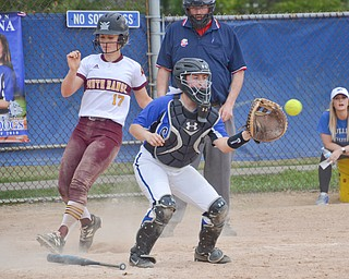 South Range's #17, Bree Kohler, crosses home plate before Poland Seminary's #2, Camryn Lattanzio, can apply the tag during their game in Poland on Saturday, April 14, 2018.
