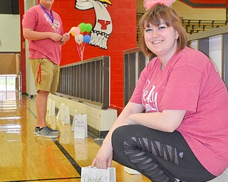 Maddie Sanders, a YSU Junior, early childhood education major, (right) and Ben Dalrymple, a YSU Junior, psychology major, (left) place paper bags with names of those who are battling cancer and those who have passed away from cancer around the track for the Luminaria Ceremony at Relay for Life at Beeghly Center on the campus of Youngstown State University on Saturday April 14, 2018.